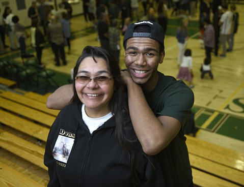 """<strong>NOT JUST ABOUT WINNING:</strong>  Though the Dons' amazing season came to a close on Saturday, the future of Ben Clay, pictured with his mom, Tina Clay, remains bright. Against all odds, including living out of their family car, Ben excelled in both basketball and life, winning S.B. High's Phil Womble Ethics in Sports Award last year. He's """"always been a good kid,"""" said Tina. """"It's his nature."""""""