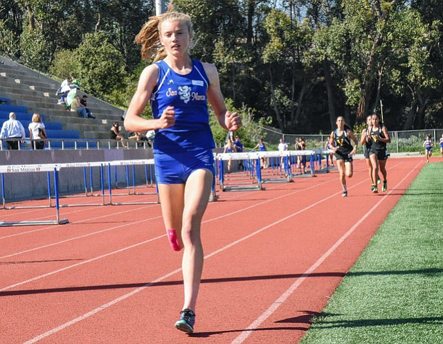 San Marcos High track standout Erica Schroeder opens up a gap against Ventura in the 1600-meter run, one of four races she won in the dual meet last week.