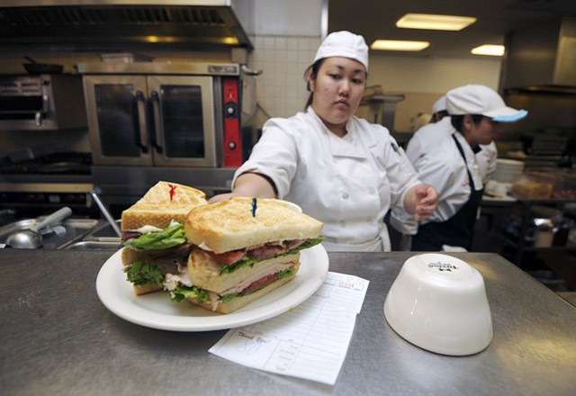 <strong>ALLEZ CUISINE! </strong>Student chefs in SBCC's Culinary Arts Department, like Rebekah Kim (above), will host a fundraiser dinner on April 11.