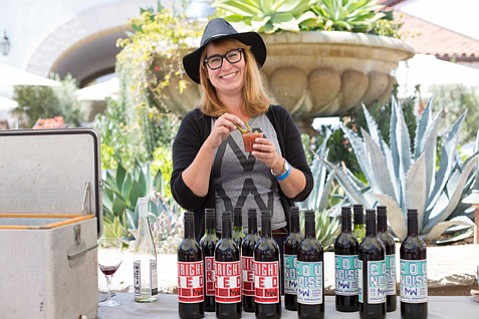 Tracey Morris pours for Municipal Winemakers on Sunday of last year's festival.