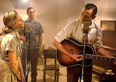 <b>MOVE IT ON OVER:</b>  Tom Hiddleston (right) stars as country legend Hank Williams in <em>I Saw the Light</em>, just one in the recent cavalcade of musician-focused biopics.