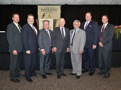 Treasurer, Sheriff David Robinson; First Vice President, Sheriff Bill Brown; President, Sheriff Donny Youngblood; Governor Jerry Brown; Second Vice President, Sheriff Steve Moore; Secretary, Sheriff David Livingston; Sergeant-at-Arms, Sheriff Dean Growdon.