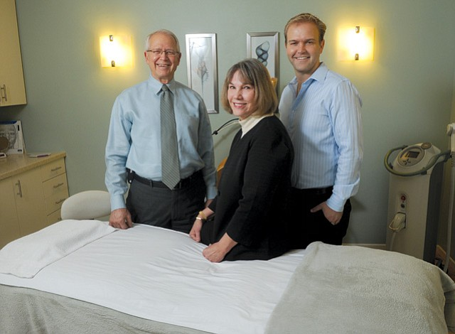 (FROM LEFT) Dr. Terry Perkins, wife Linda Perkins, and son Brian