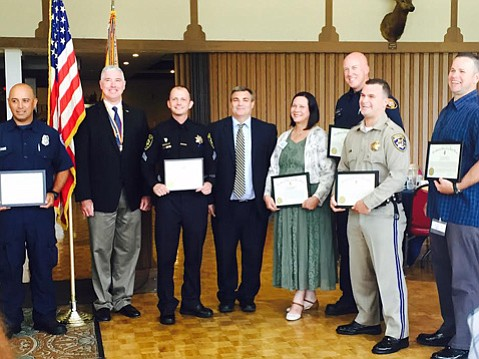 Dispatcher Pennye Sasaki-Benda (fifth from right) and five others were honored last week for outstanding service to Santa Barbara County by the Military Order of the World Wars.