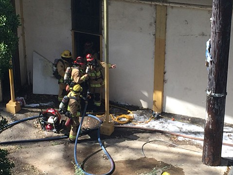 Firefighters respond to a small fire under Santa Barbara High School's stadium seating