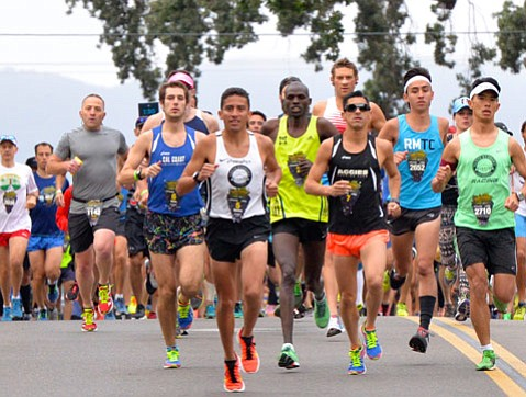 """<strong>STRATEGIZED STEPS:</strong>  Last year's winnerRamiro """"Curly"""" Guillen (above in white) released his beast within to win the Wine Country Half Marathon."""