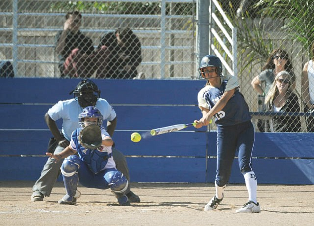 """<strong>DIAMOND SMASHING:</strong> Dos Pueblos High's Madison Pickett connects on one of her three hits against San Marcos last Friday. Pickett, bound for MIT, says softball helps her """"relax my brain."""""""
