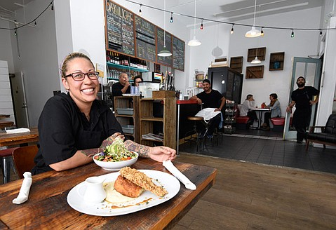 <strong>RINGING DINNER BELL:</strong>  Chef Toi Dennis now serves Blue Owl's Chicken 'n' Biscuit and Farmer's Sink Salad to dinner crowds with a smile.