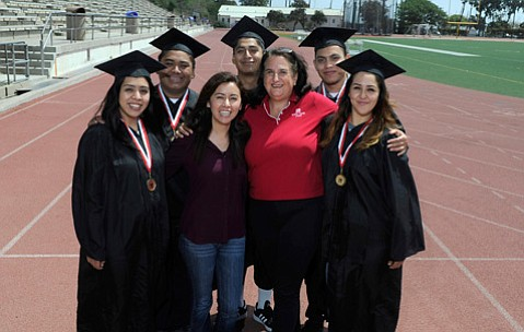 <strong>GRADS IN GOWNS:</strong>  High school grads can ease into the academic demands of college life through Running Start. Pictured (from left) are Daisy Torres Lopez, Kevin Garcia, Alejandra Martinez, Rene Santana, Extended Opportunity Programs and Services Director Marsha Wright, Luis Cisneros, and Alisha Sanchez.