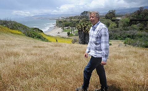<strong>BIG SELL:</strong> Realtor Kerry Mormann stands at Naples, overlooking Dos Pueblos and, farther up the coast, Las Varas. The combined asking price for all three is nearly $200 million.