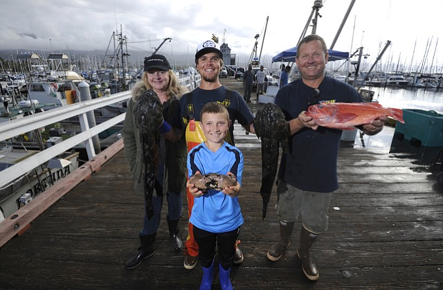The Teall family—(from left) Katie, Parker, August, and Paul—gather at Saturday morning's Fisherman's Market on May 7, 2016.