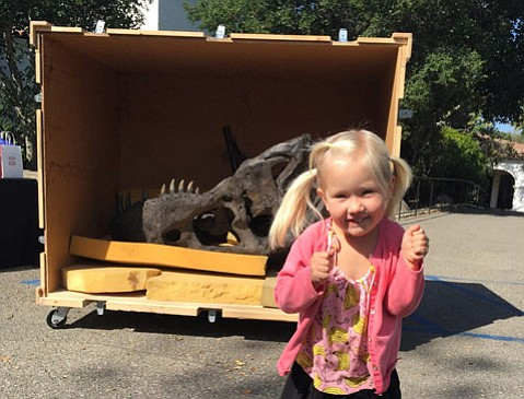 "The author's daughter,  Isida Gruzdeva, poses with the ""T. Rex Named Sue."""