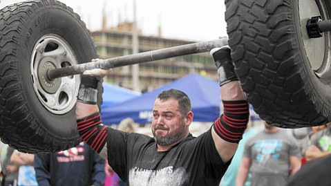<b>ALL MUSCLE:  </b>Santa Barbara Police Officer Jacob Finerty lifted 290 pounds of tires over his head in the Axle Clean & Press during the 2015 California's Strongest Man competition. At the time, he was on paid injury leave from the department and collecting more than $130,000 in salary and benefits.