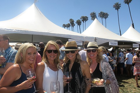 Melissa Paxton, Tricia Edwards, Stephanie Manser, and Stacy Manser enjoy the Beachside Wine Festival.
