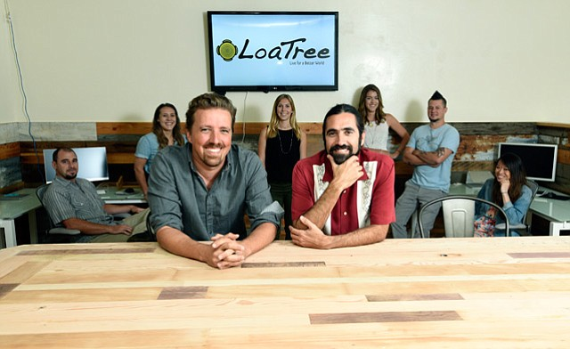 <b>HAPPY FAMILY IN NEW HOME:  </b>David Fortson (front left), Eric Cardenas (front right), and the rest of the Loa crew moved into their new East Haley Street space about two months ago.