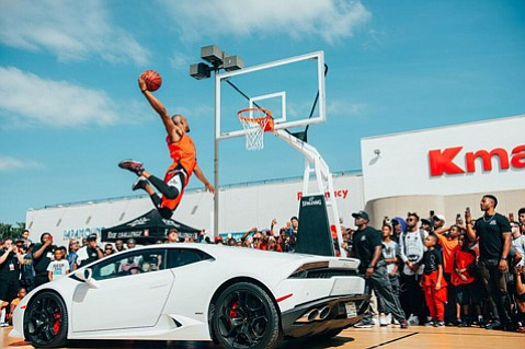 """Hi-jinks are the game of the day at Kmart's parking lot when Chris Staples and top """"dunk masters"""" appear for a promotion on Saturday."""