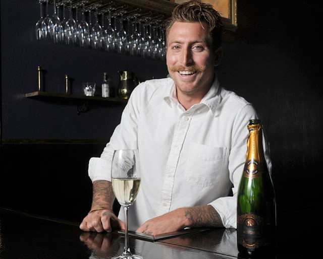 <b>SPARKLING SMILE: </b> Scott Manser (pictured) and Damian Gover run The Champagne Room on West Haley Street.