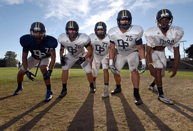 <b>FEARSOME FIVESOME:</b> Dos Pueblos High's defensive front line includes (from left) Matt Molina, Erick Nisich, Justin Padilla, Nathan Beveridge, and Marcellous Gossett.