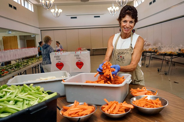 <b>ILL BUT WELL-FED:</b> Food from the Heart volunteers — including the organization's founder, Evelyn Jacob— work in the Trinity Lutheran Evangelical Church kitchen each week to cook and then deliver gourmet meals to sick people around Santa Barbara.