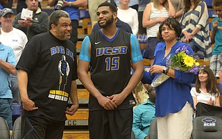 <b>FUTURE SUN:</b> Alan Williams is flanked by his parents, Cody and Jeri, during a ceremony before his last UCSB home basketball game in 2015.