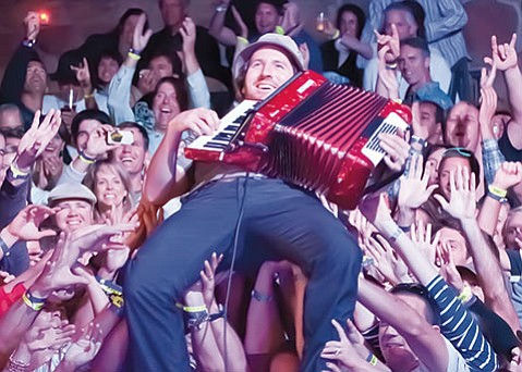<strong>HAVE A HOLLY JOLLY ELLWOOD:</strong> Get into the giving spirit when ace accordionist Zach Gill (above) hosts an Ellwood Elementary Extravaganza fundraiser at SOhO on Sunday.