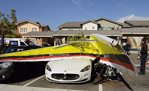 The ultralight crashed through a carport before striking multiple vehicles.