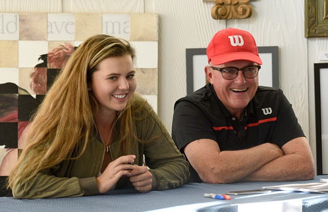 <b>GRAND SLAM DREAMS: </b>Santa Barbara tennis star Kayla Day had teaching pro Larry Mousouris at her side when she told of her decision to turn professional at age 17.