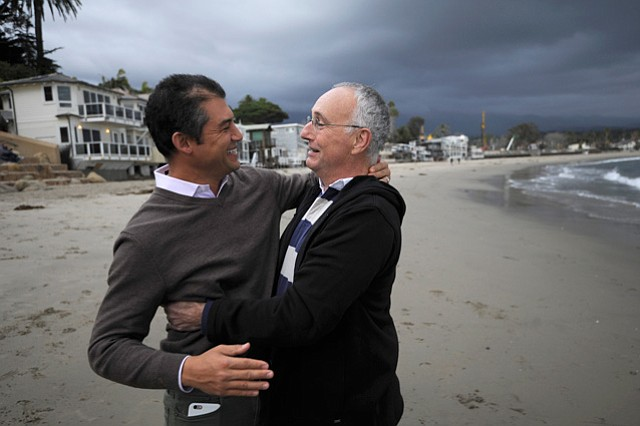 Das Williams gets a hug from Peter Sperling, a longtime benefactor for the new 1st District county supervisor.
