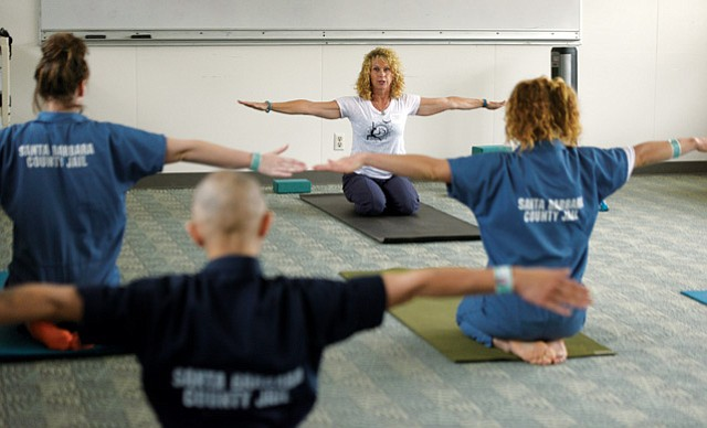 INNER FREEDOM: Ginny Kuhn (pictured in the background) leads a class at the Santa Barbara County Jail. She views her classes as a service to the inmates.