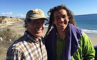 Rob Rebstock, pictured here with his son, Patrick, died while surfing at Hollister Ranch on January 29.