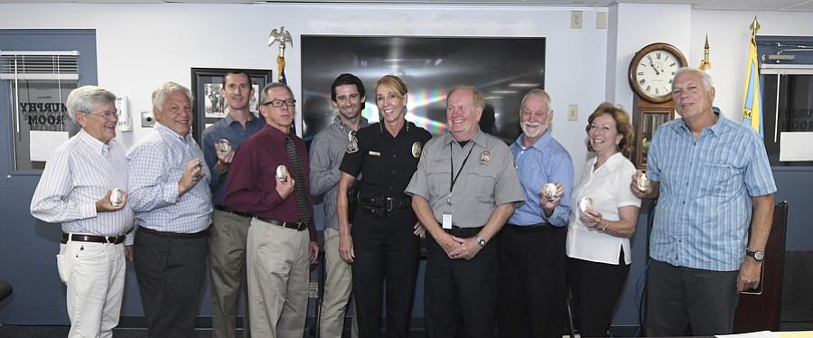 Police Chief Lori Luhnow swears in nine members of the department's new Volunteers in Policing (VIP) initiative