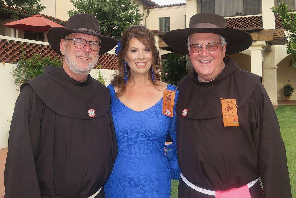Father John Hardin, Guardian of the Franciscan Fraternity and Interim Administrator of St. Barbara Parish, La Presidente Rhonda Henderson, and Associate Pastor of St. Barbara Parish Father Larry Gosselin.