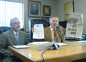"Jerry Robert's attorney Dennis Merenbach holds up the News-Press ""front page smear."""