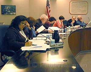 It was hard times at the school board Tuesday night, as boardmembers struggled mightily to pull the trigger on millions of dollars' worth of mandatory budget cuts.
