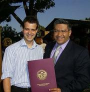Supervisor Salud Carbajal gives a county resolution to Guillaume Doane.