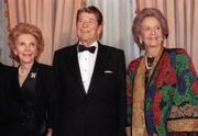 President Ronald Reagan and First Lady Nancy Reagan stand with Katharine Graham (at right, not to be confused with another publisher named Wendy McCaw).