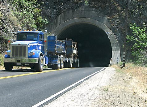 A gravel truck rumbles through one of the three Matilija Tunnels in the Los Padres National Forest.