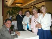 Montecito resident Joan Rocco buys an autographed copy of <em>The Mexican Mafia</em> from Tony Rafael.