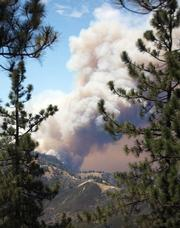 Towering clouds of smoke rise thousands of feet into the air as the fire crosses over Zaca Ridge and heads down toward Manzana Creek.
