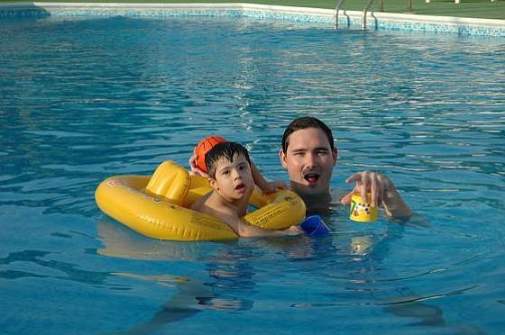 Brent teaches Jamal to swim.