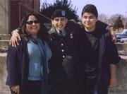 Jaime with his older sister, Elizabeth (left), and younger brother, Alex (right), at his graduation from basic training in Fort Knox, Kentucky