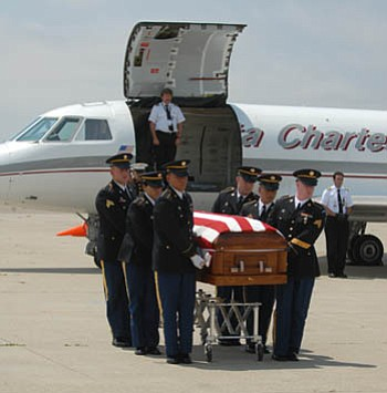 The body of Rodriguez arrives home to Santa Barbara from Iraq. The Honor Guard takes Rodriguez's casket, draped in an American flag, away from the plane.