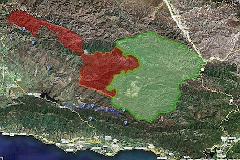Shows potential perimeter of the burn area in green with current fire area in red.