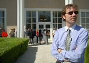Former <em>News-Press</em> editor Michael Todd waits to enter the federal courtroom on August 14, along with dozens of other subpoenaed witnesses.