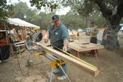 Glen Smith (middle left) builds signs for the base camp. 