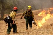 Hot Shots work to protect the Sisquoc River area during the middle days of the fire with drip-torch burns.