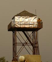 Observer looking down on the Brubaker firing operation from the Cuyama lookout tower. it was wrapped two weeks ago.