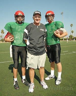 SBCC football coach Craig Moropoulos (center) with sophomore quarterback Nick Acciani (left) and freshman quarterback Conner Rehage (right) at the Vaqueros' La Playa Stadium.