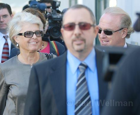 Wendy McCaw (left) and her co-publisher/fiancee Arthur von Wiesenberger (right) exit the courthouse behind attorney Barry Cappello.