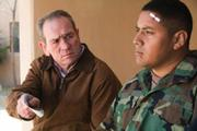 Private Ortiz (Victor Wolf, at right) doesn't want to answer questions.